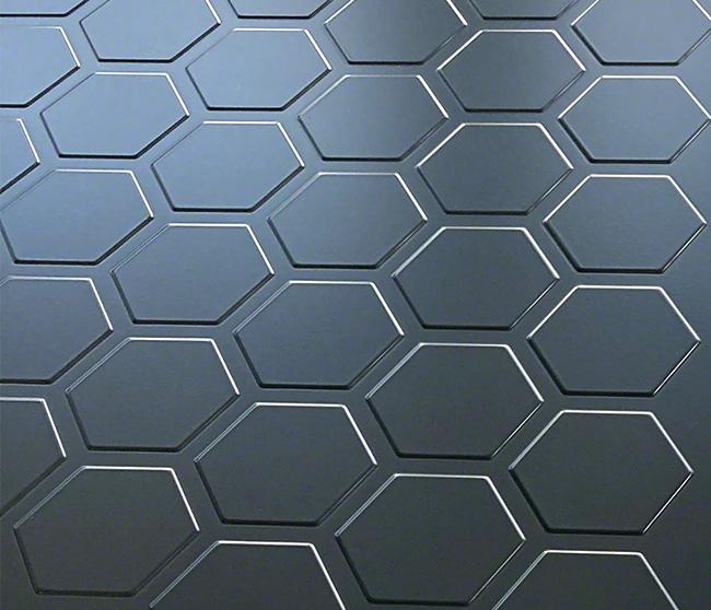 金属材料にエンボス加工により凹凸をつけて立体的な表現を施した内装・外装パネル(デザインエンボス 六角 塗装)